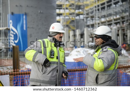 Tobolsk, Russia - June 14, 2018: Worker at the factory. Construction of a petrochemical and oil refinery near the city of Tobolsk in Russia, workers working on the installation and construction of the #1460712362