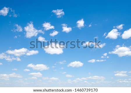 Bright beautiful blue sky with clouds for background or texture.