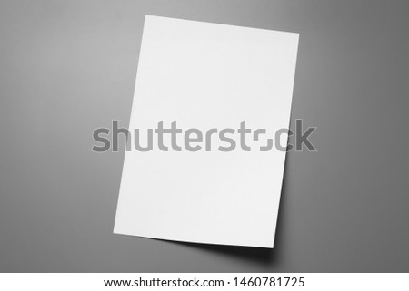 Blank paper sheets for brochure on grey background, top view. Mock up Royalty-Free Stock Photo #1460781725