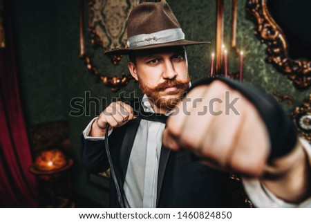 A portrait of an adult man  posing in the interior. Men's beauty, fashion, style. #1460824850
