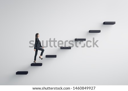 Side view of young businesswoman climbing stairs to success on concrete wall background. Leadership and career development concept Royalty-Free Stock Photo #1460849927