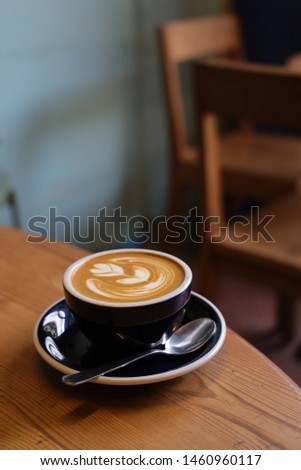 coffee latte art on the wood desk in coffee shop cafe in vintage color tone  #1460960117