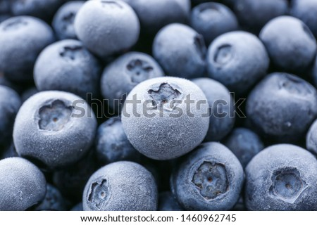 Tasty frozen blueberries, closeup view Royalty-Free Stock Photo #1460962745