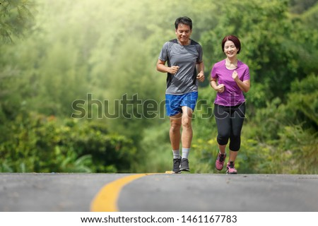 Asian middle aged couple  jogging exercise in park #1461167783