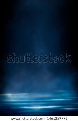 Wet asphalt, reflection of neon lights, a searchlight, smoke. Abstract light in a dark empty street with smoke, smog. Dark background scene of empty street, night view, night city. #1461259778