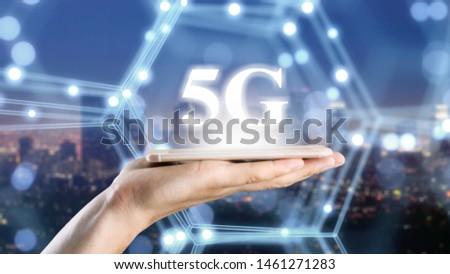 Businessman on blurred background using 5G network #1461271283