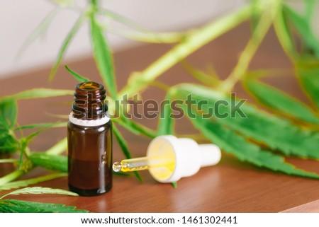 Bottle of CBD cannabis oil. Health marijuana with cannabidiol content. Pharmaceutical hemp drug preparation with safe cannabinoids #1461302441