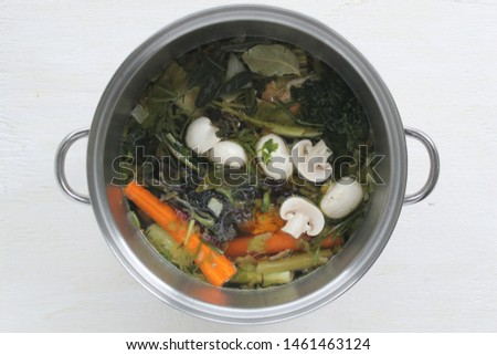 Vegetable scraps used to create zero-waste homemade broth. Vegetable stock that fights food waste!