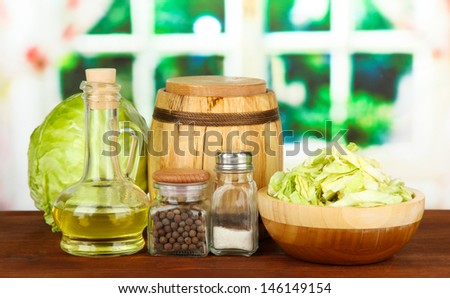 Green cabbage, oil, spices on cutting board, on bright background #146149154