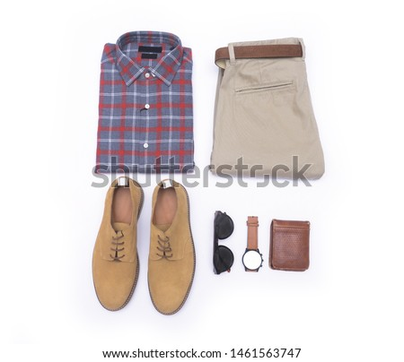 Top view of folded long sleeve plaid shirt and khaki pants ,watch with belt and brown shoes ,sunglasses,purse on white background  #1461563747