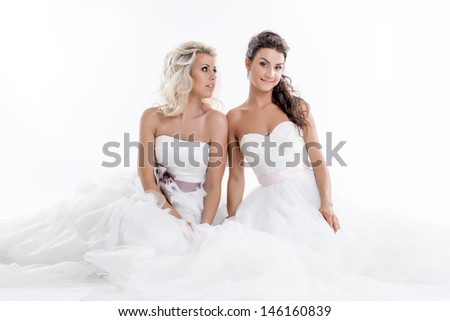 Two smiling young brides isolated on white #146160839