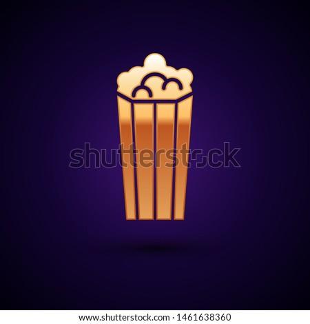 Gold Popcorn in cardboard box icon isolated on dark blue background. Popcorn bucket box.  Vector Illustration #1461638360