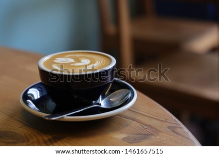 coffee latte art on the wood desk in coffee shop cafe in vintage color tone  #1461657515
