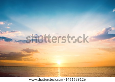 Beautiful sunset sky above clouds with dramatic light #1461689126