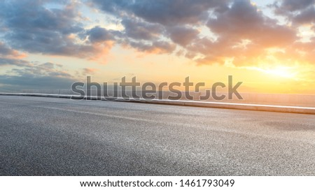 Asphalt highway and beautiful clouds landscape at sunset #1461793049