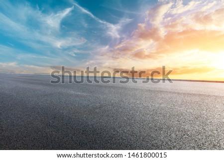 Asphalt road and beautiful clouds landscape at sunset #1461800015