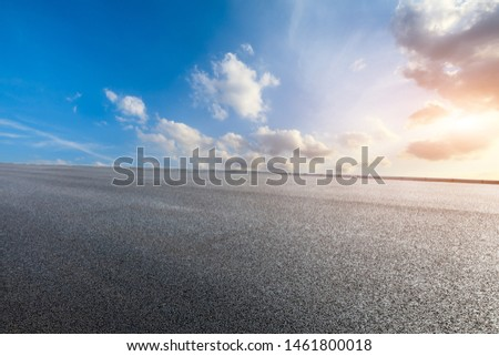 Asphalt road and beautiful clouds landscape at sunset #1461800018