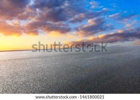 Asphalt road and beautiful clouds landscape at sunset #1461800021