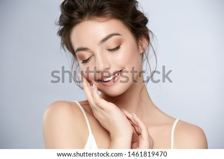 woman with perfect nude make-up with golden shadow smiling and touching face, girl closed eyes and smile #1461819470