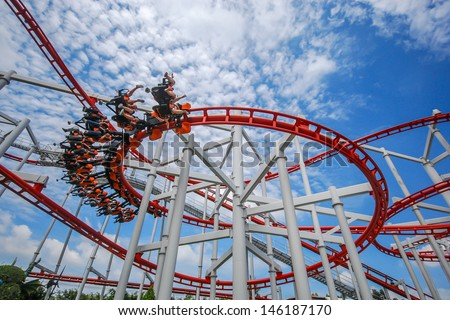 Rollercoaster against blue sky Royalty-Free Stock Photo #146187170