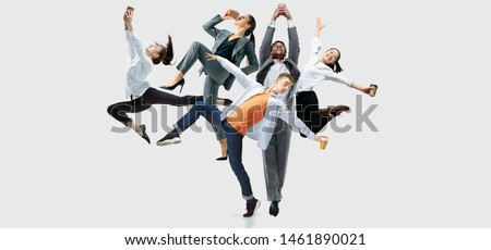 Happy office workers jumping and dancing in casual clothes or suit with folders on white. Ballet dancers. Business, start-up, working open-space, motion and action concept. Creative collage. Royalty-Free Stock Photo #1461890021