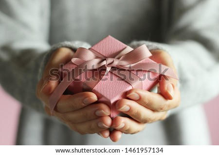 gift box in female hands. Holiday, give, gift.