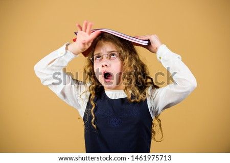 Girl hold textbook folder test. Preparing to exams in library. Small child formal wear. Prepare for exam. Formal education and homeschooling. Check knowledge. School exam concept. Final exam coming. #1461975713