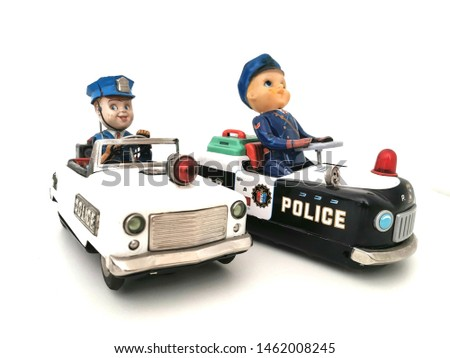 Two Tin Toy Police Cars
