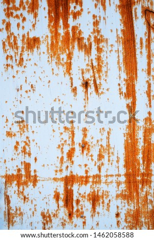 Rusted white painted metal wall. Rusty metal background with streaks of rust. Rust stains. Rust texture. #1462058588