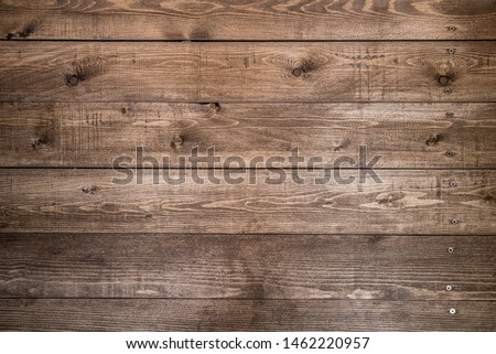 Old brown wood background made of dark natural wood in grunge style. The view from the top. Natural raw planed texture of coniferous pine. The surface of the table to shoot flat lay. Copy space #1462220957