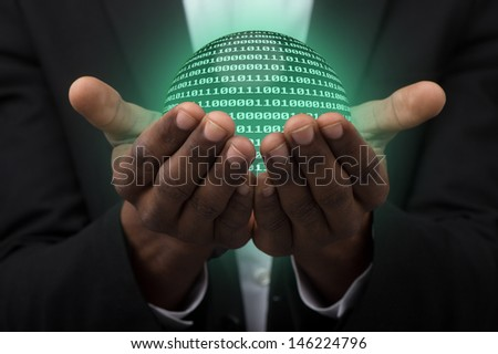 businessman holding globe made from binary code. #146224796