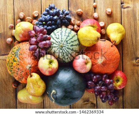 Vegetables and fruits on a wooden background Royalty-Free Stock Photo #1462369334