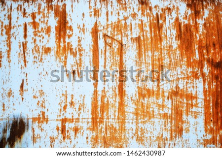 Rusted white painted metal wall. Rusty metal background with streaks of rust. Rust stains. Rust texture. #1462430987