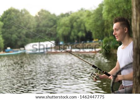 Young man fishing on a lake. #1462447775
