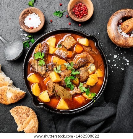 Beef meat  stewed with potatoes, carrots and spices (hungarian goulash). #1462508822