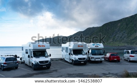 Wellington, New Zealand, July 27 2019: Britz camper vans park for the night at a designated/approved freedom camping spot on the south coast of Wellington New Zealand #1462538807