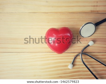 close up red heart and stethoscope on old wood table, copy space background for text, world health day, medical and healthcare, life insurance business technology concept #1462579823