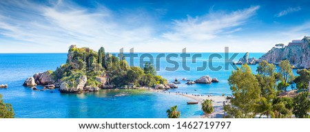 Panoramic view of Isola Bella, small island near Taormina, Sicily, Italy. Narrow path connects island to mainland Taormina beach surrounded by azure waters of Ionian Sea. Royalty-Free Stock Photo #1462719797