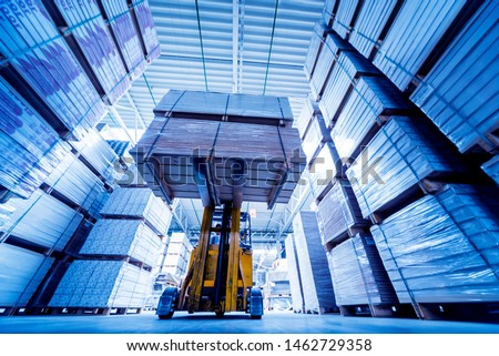 Forklift loader in storage warehouse ship yard. Distribution products. Delivery. Logistics. Transportation. Business background #1462729358