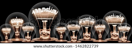 Large group of light bulbs with shining fibers in a shape of Innovation, Inspiration, Creativity and Idea concept related words isolated on black background; horizontal composition #1462822739