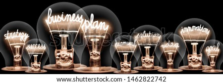 Large group of light bulbs with shining fibers in a shape of Business Plan, Strategy, Innovation and Success concept related words isolated on black background #1462822742