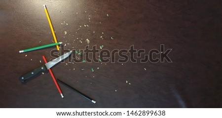 Knife sharpening pencils. Sharpen pencils. Sharpening pencils #1462899638