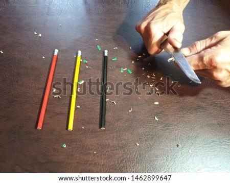Knife sharpening pencils. Sharpen pencils. Sharpening pencils #1462899647