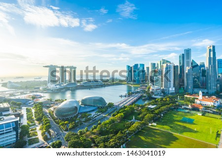 Beautiful architecture building exterior cityscape in Singapore city skyline with white cloud on blue sky Royalty-Free Stock Photo #1463041019