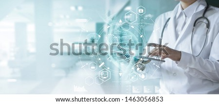 Medicine doctor touching electronic medical record on tablet. DNA. Digital healthcare and network connection on hologram modern virtual screen interface, medical technology and futuristic concept. Royalty-Free Stock Photo #1463056853