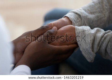 Mixed ethnicity family couple holding hands express support trust hope in marriage relationship, african black man friend husband give comfort compassion empathy to white woman wife, close up view #1463201219