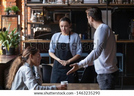Furious man stand dispute with guilty waitress bringing wrong order, mad client couple get nervous disappointed with bad service or waiter incompetence, blame stuff yell and shout in public place #1463235290