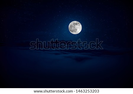 backgrounds night sky with stars and moon and clouds. Beautiful full moon over clouds during night time