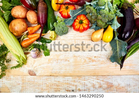 Fresh colorful organic vegetables from above. Top view, flat lay. Different vegetables for eating healthy on wooden background. Clean eating food frame. Copy space. Vegetarian, vegan. #1463290250