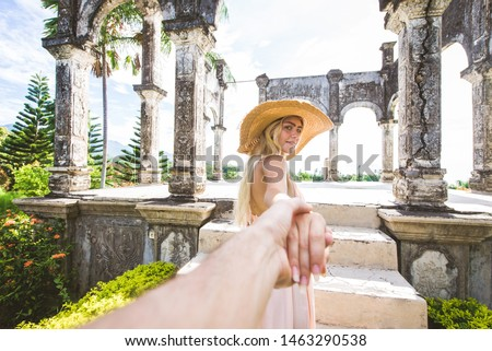 Young beautiful woman in Taman Ujung water palace, Bali island, Indonesia - Travel blogger exploring Water Palace in Bali #1463290538